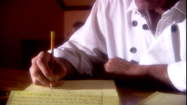 a writer takes notes on a legal pad. - report stock videos & royalty-free footage