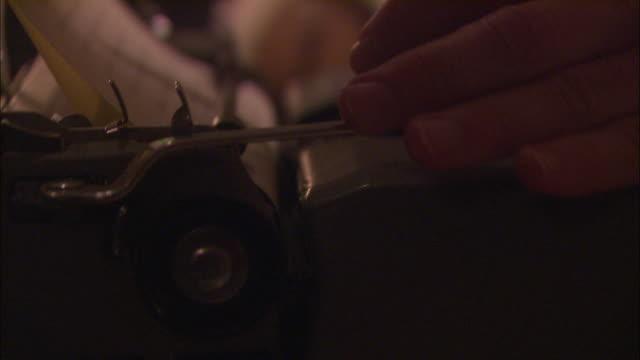 a writer uses a typewriter. - schreibmaschine stock-videos und b-roll-filmmaterial