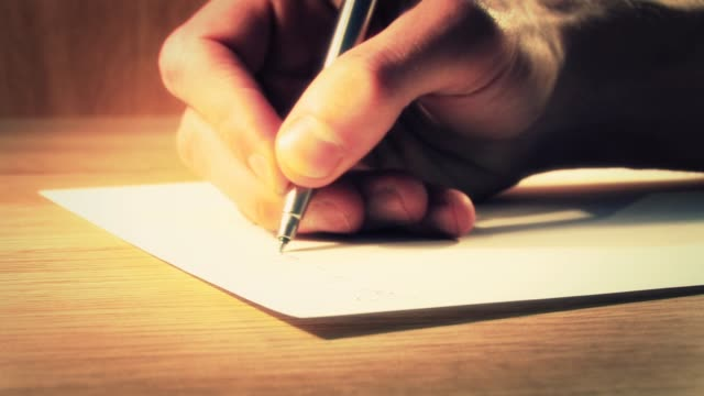 writing a letter - close up - messaggio video stock e b–roll