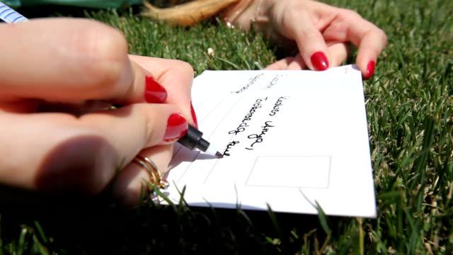 writing a postcard