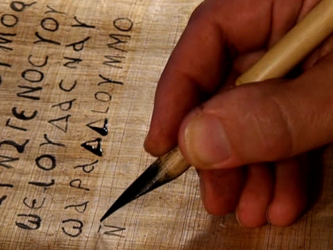 Writing ancient manuscript