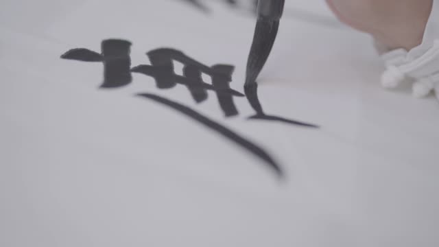 writing chinese calligraphy on rice paper, log color mode - non western script stock videos & royalty-free footage