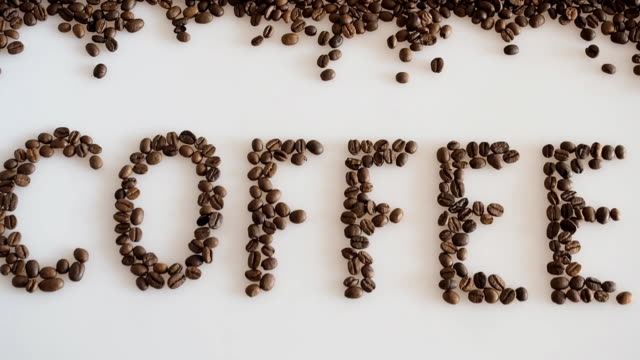 writing coffee made of coffee beans. - dry stock videos and b-roll footage