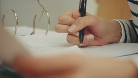 vídeos y material grabado en eventos de stock de escrito de - examen