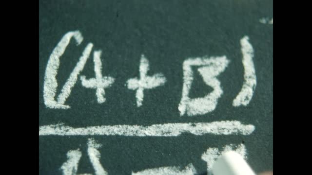 cu writing formula on chalkboard - mathematics stock videos & royalty-free footage