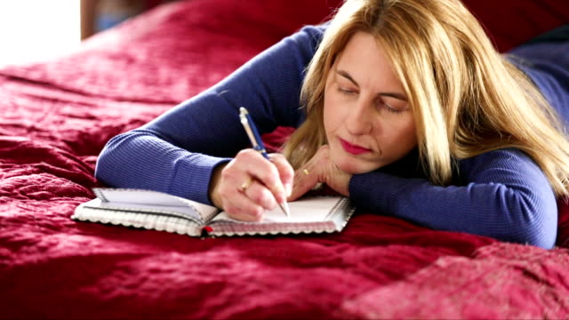 writing in a diary - only mature women stock videos and b-roll footage