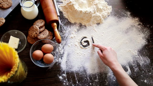 writing in flour gluten free - recipe stock videos & royalty-free footage