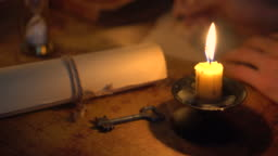 writing letter in candlelight