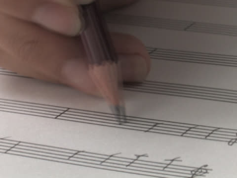 writing music angle view - sheet music stock videos & royalty-free footage