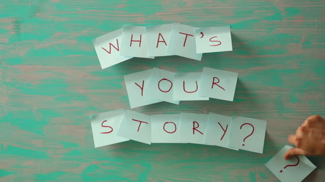 writing note showing what's your story question. - storytelling stock videos and b-roll footage