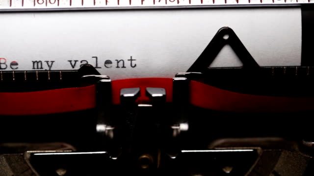 writing short phrase 'be my valentine' with an old typewriter - short phrase stock videos and b-roll footage