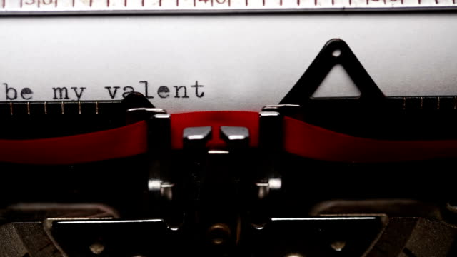 writing short phrase 'will you be my valentine' with an old typewriter - short phrase stock videos and b-roll footage