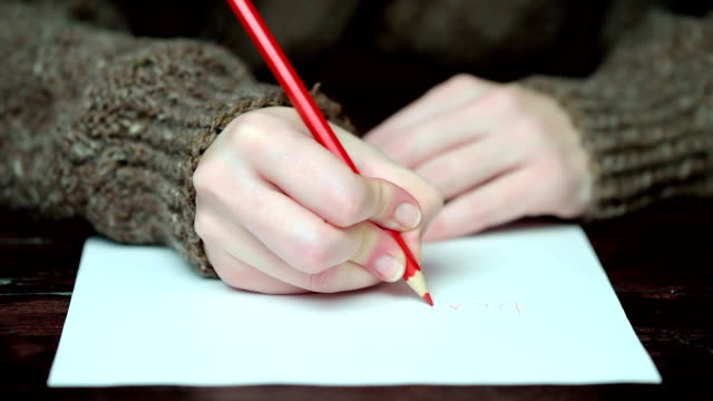 writing with red pencil - greeting card stock videos & royalty-free footage