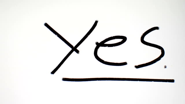 writing yes on white - yes single word stock videos & royalty-free footage