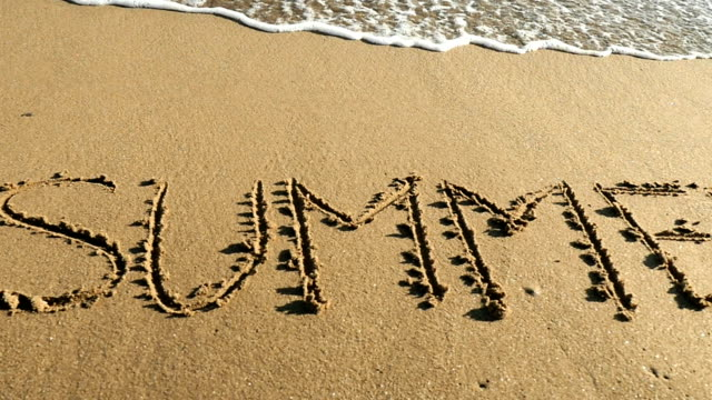 SUMMER written in sand