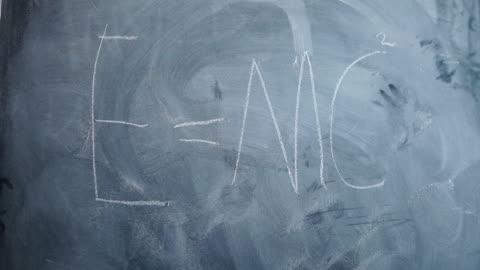 e=mc2 written on children's blackboard - e=mc2 stock-videos und b-roll-filmmaterial