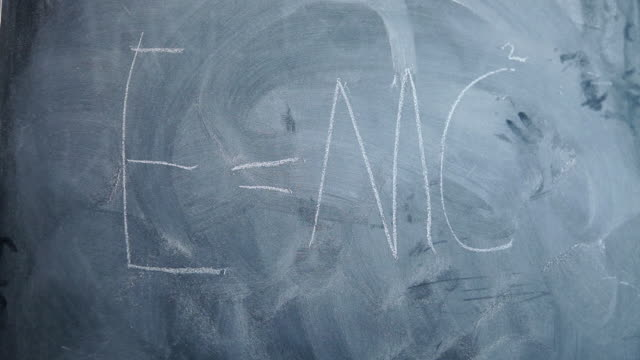 e=mc2 written on children's blackboard - e=mc2 stock-videos und b-roll-filmmaterial