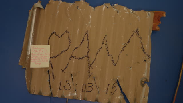 """vanuatu - march 31, 2015: """"pam"""" written on corrugated iron with sticky note thanking promed - thank you stock videos & royalty-free footage"""