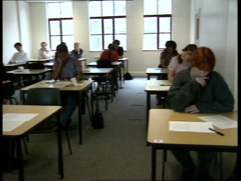 written paper england london sw8 wyvil rd test centre itn lms learner drivers sitting at individual tables waiting to take the written driving test... - driving test stock videos and b-roll footage