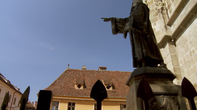 A wrought iron fence encloses the statue of Honterus in front of Black Church.