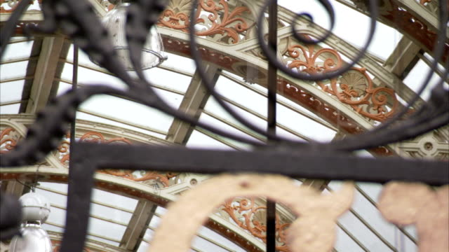 a wrought iron gate covers the entrance to the victoria quarter in leeds, england. available in hd. - leeds stock videos and b-roll footage
