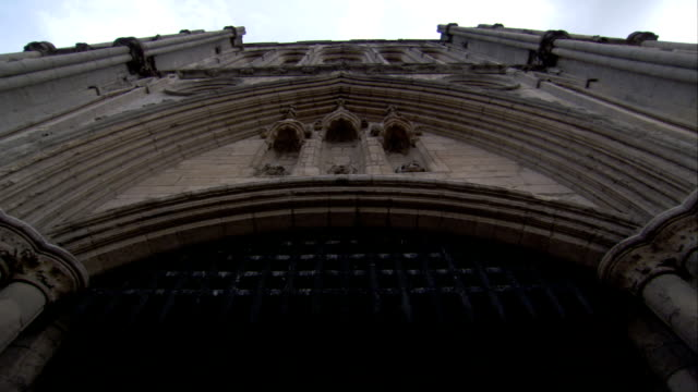 a wrought iron gate hangs in the top of the abbey gate, bury st edmunds available in hd. - bury st edmunds stock videos & royalty-free footage