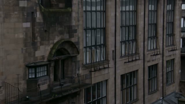 wrought iron guards cover the windows on the glasgow school of art building. available in hd. - charles rennie mackintosh stock videos and b-roll footage