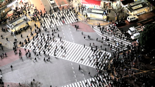 ws aerial crowds of people crossing famous crosswalks at  centre of shibuyas fashionable shopping and entertainment district / tokyo, japan - shibuya crossing stock videos & royalty-free footage
