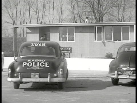 ws ext police station squad car pulling into parking place 'police headquarters' sign ws policemen walking in others out of station - levittown pennsylvania stock videos and b-roll footage