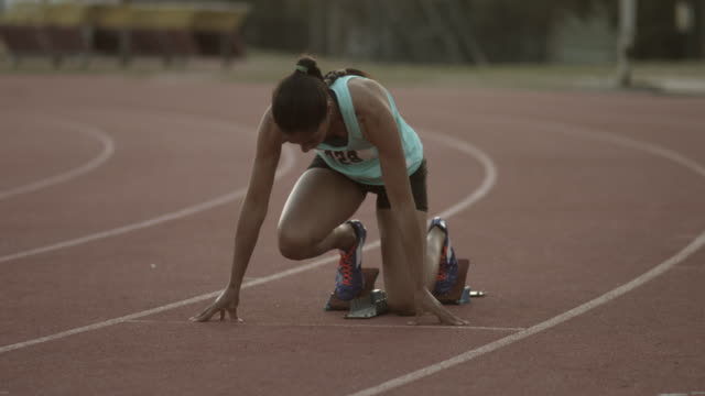 WS_Female track athlete preparing for sprint