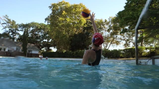 WS_Female waterpolo goalkeeper saving a shot