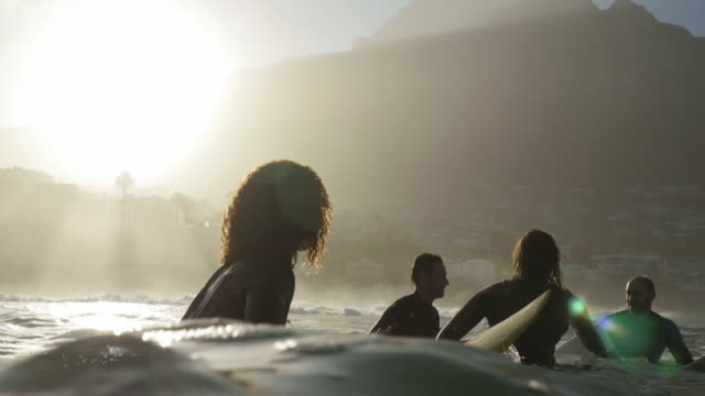 ws_four surfers in the ocean, waiting for waves - surf stock videos & royalty-free footage