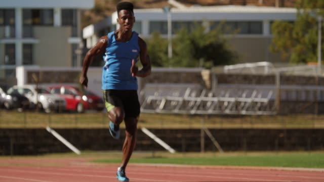 ws_male track athlete sprinting on track - track and field event stock videos and b-roll footage