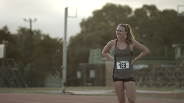 WS_Portrait of smiling female track athlete at stadium
