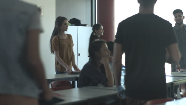 ws_students finding their seat in classroom - female high school student stock videos and b-roll footage