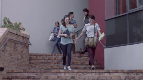 ws_students walking out of school building - staircase stock videos & royalty-free footage