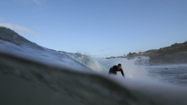 ws_surfer in the ocean, riding on wave - wetsuit stock videos & royalty-free footage