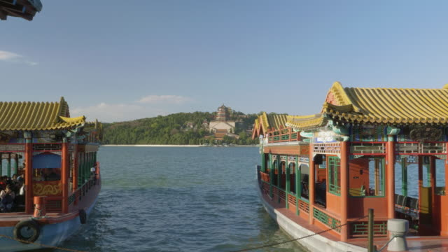ws_tourboats on shore of kunming lake, summer palace, unesco world heritage site, beijing, china - summer palace beijing stock videos & royalty-free footage