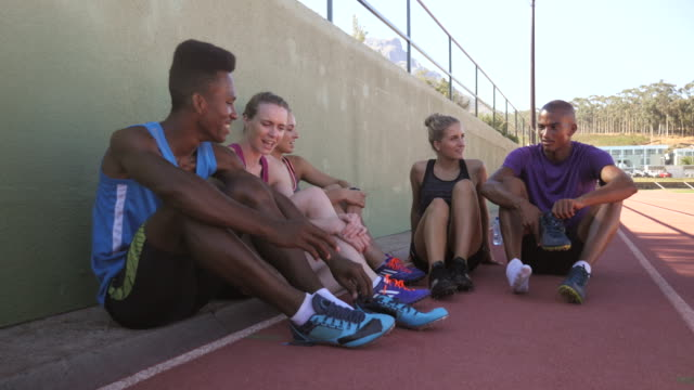 ws_track athletes chatting and relaxing, at stadium after practice - track and field event stock videos & royalty-free footage