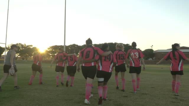WS_Womens rugby team walking away on the field together, after game