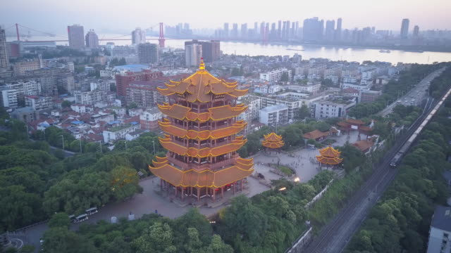 wuhan yellow crane tower spining shot - temple building stock videos & royalty-free footage