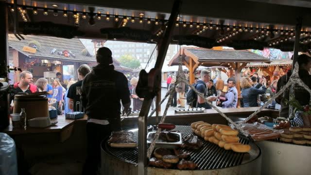 wurst-sausage market stall at food and drink festival - german fast food at it's best, alexanderplatz - fast food stock-videos und b-roll-filmmaterial