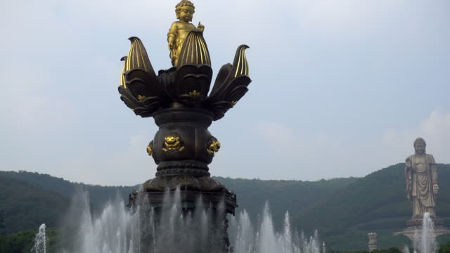 wuxi lingshan great buddha scenic area,kowloon filling and bath - wuxi stock videos and b-roll footage