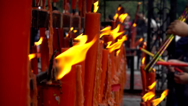 wuxi lingshan great buddha scenic area,lit candles - votive candle stock videos and b-roll footage