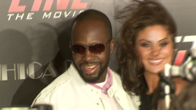 Wyclef Jean and Nadia Bjorlin at the 'REDLINE' Los Angeles Premiere at Grauman's Chinese Theatre in Hollywood California on April 12 2007