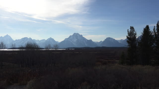 wyoming broad view of tetons in afternoon zoom in - teton range stock videos & royalty-free footage