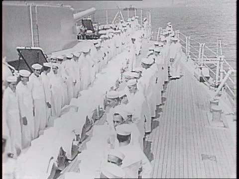 wyoming in the harbor and us naval volunteer cadets on board small boat headed to ship for training / overhead shot of volunteers on deck of boat /... - 船の一部点の映像素材/bロール