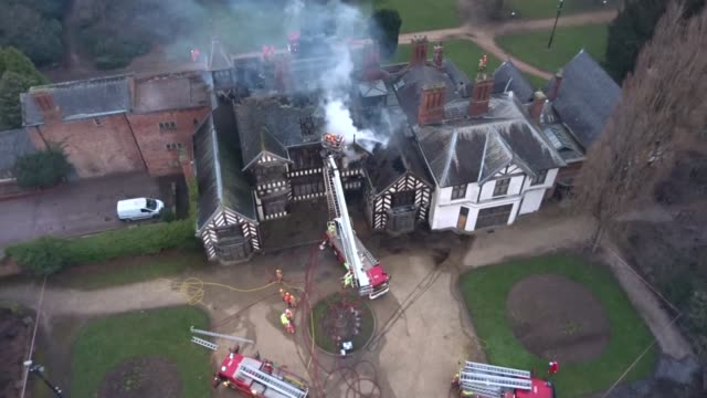 wythenshawe hall bady damaged by fire england greater manchester wythenshawe views / aerials drone footage firefighters hosing down smouldering roof... - tudor stock videos and b-roll footage
