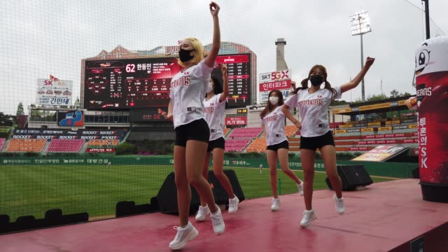sk wyverns cheerleaders at club's happy dream ballpark during the korean baseball organization league opening game between sk wyverns and hanwha... - coreano video stock e b–roll