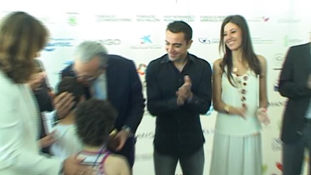 Xavi Hernandez and Nuria Cunillera attend the inauguration of a new childern's hospital wing at Hospital Sant Joan de Deu